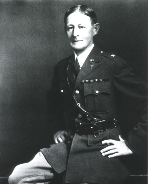 <p>Three-quarter length, seated, left pose, full face; wearing uniform (Brigadier General) with Sam Brown belt; hands on hips.</p>