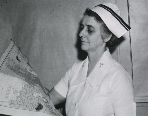 <p>Head and shoulders, left profile, looking at war map.</p>