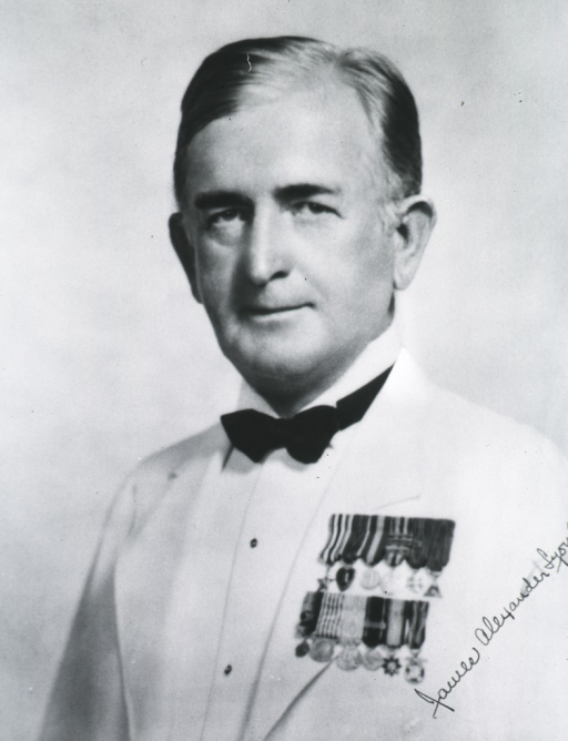 <p>Head and shoulders, full face, medals on lapel.</p>