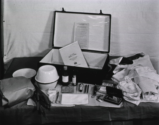 <p>View of typical contents, including a delivery bag, used for Lay-Midwife, 1945.</p>