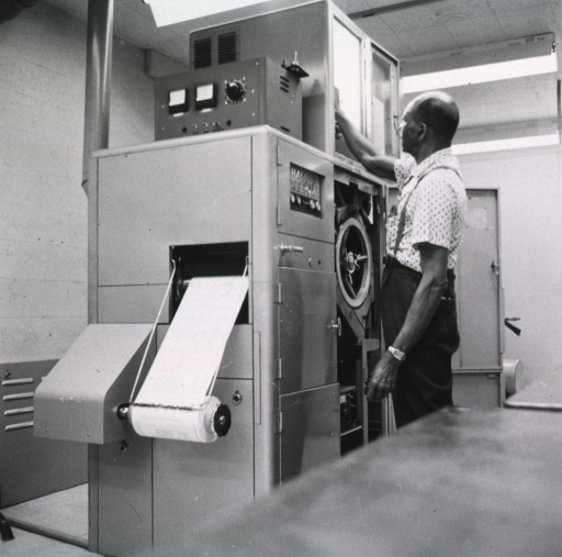 <p>Interior view: Copy flo machine is printing from microfilm on to paper.</p>