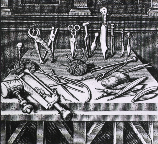<p>Various surgical equipment and instruments arranged on a table.</p>