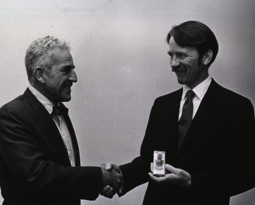 <p>Dr. Frank E. Lundin, Jr. is presented the U.S. Public Health Service Commendation Medal by Dr. Leon Jacobs.</p>