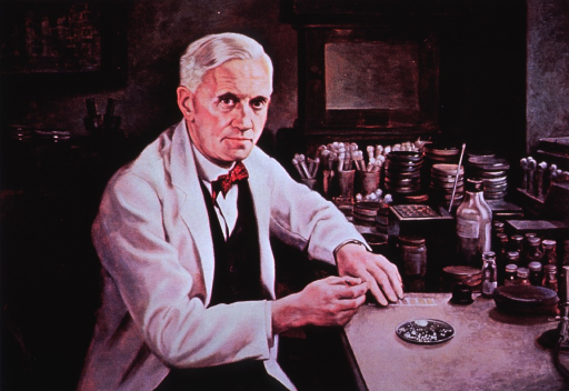 <p>Half-length, seated at laboratory table, full face, wearing white lab coat, showing laboratory equipment.</p>