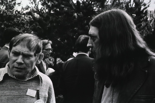 <p>Dr. Sydney Brenner (left, facing front), Roy Curtis III (right, behind Dr. Brenner), and unidentified persons at the Asilomar Conference, Pacific Grove, California, February 24-27, 1975.</p>
