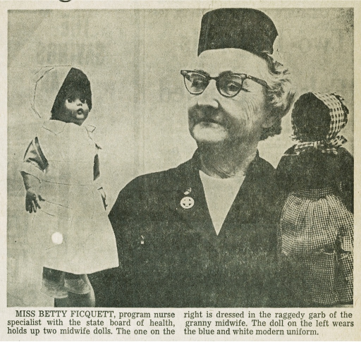 <p>Betty Ficquett, state nurse, displays two dolls, one in traditional clothes, one in a modern uniform, in a newspaper photo from The State (Columbia, S.C.), November 22, 1968. These training aids, illustrating trends in midwifery dress, are part of NLM's American College of Nurse-Midwives archives.</p>