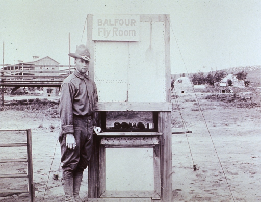 <p>Showing an American soldier standing in front of a Balfour Fly Room.</p>