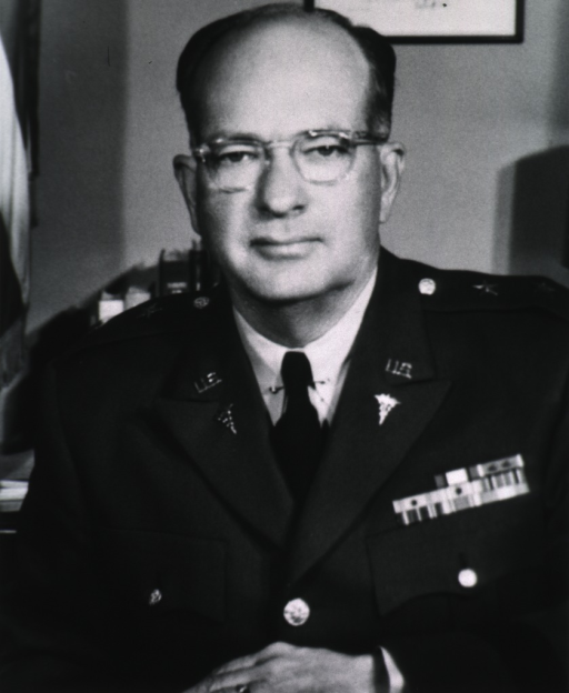 <p>Head and shoulders, full face; wearing uniform (Major General) and glasses.</p>