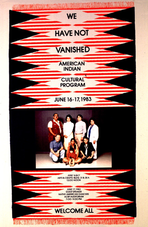 <p>The poster background is a red, white, and blue Navajo rug.  The photograph in the center is a grouping of eight people.  The age range is middle aged to child; one man is wearing a fringed vest, the teenager is wearing a buckskin dress and feathers in her hair, and the others wear more mainstream clothing.</p>