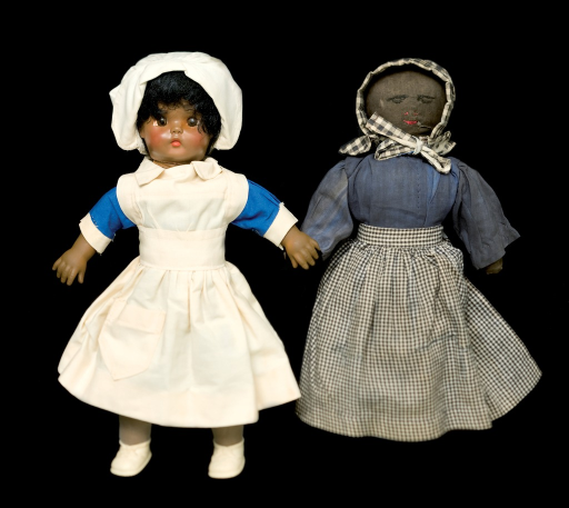 <p>This color photograph displays two training dolls used by South Carolina midwife supervisor Laura Blackburn (1891-1955) depicting traditional and modern styles of midwife dress.  The traditional doll was made by Laura Blackburn around 1950.  These are part of NLM's American College of Nurse-Midwives archives.</p>