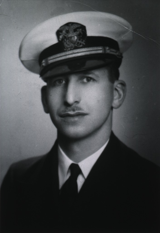 <p>Head and shoulders, full face, wearing white cap with USPHS insignia.</p>