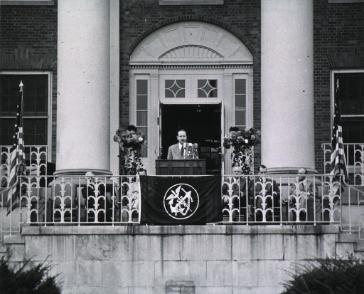 <p>Showing podium area, Leonard Scheele speaking.  Seated are: Dr. Dyer, Norman Topping, Oscar Ewing, unidentified person, and William Sebrell.</p>