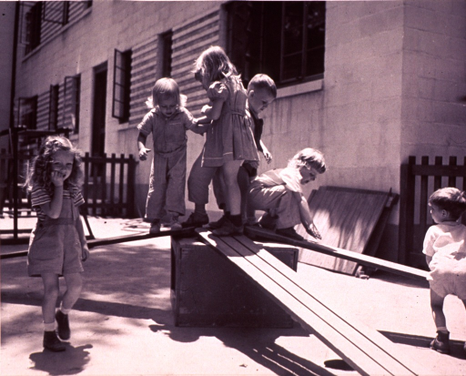 <p>Children playing on boards in a child care center.</p>