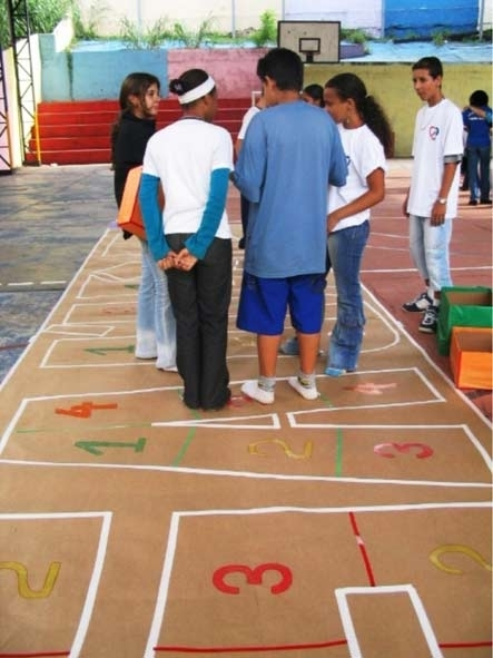 A hopscotch game was part of a lesson on healthy foods.