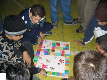 Peers play a board game.