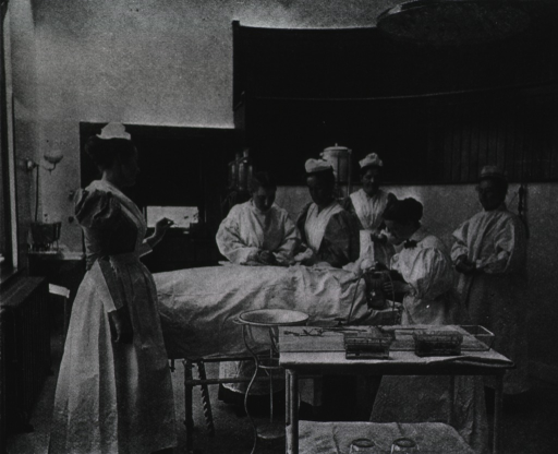 <p>Interior view of the operating room with an operation in progress; the physician, the nurses, and the anesthetist are all women.</p>