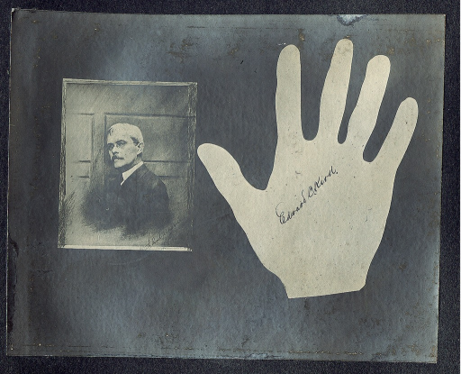 <p>Photograph of Edward C. Kirk and his hand silhouette. Photograph and hand silhouette are both signed by subject.</p>