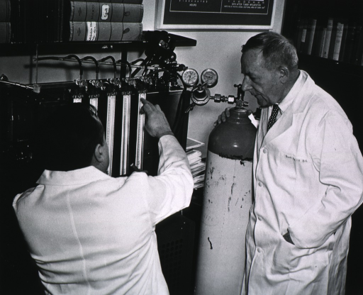 <p>Showing Dr. Warburg, an associate, and the Warburg manometer.</p>
