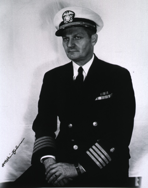 <p>Half-length, seated, left pose; wearing naval uniform and cap (Captain).</p>