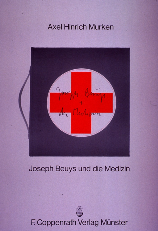 <p>Predominantly white poster with black lettering.  Initial title phrase at top of poster.  Visual image is a color photo reproduction featuring a brief case with a red cross emblazoned on it.  The cross bears the remaining title text in fairly poor handwriting.  That text is repeated in clear printing below the photo.  Publisher information at bottom of poster.  The poster publicizes a book, Joseph Beuys and medicine, written by Murken and first published in 1979.  Beuys was an artist who worked in Germany after WWII (d. 1986) and apparently explored themes of medicine and healing in his art.</p>