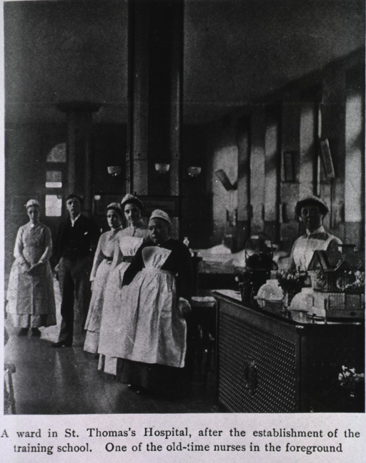<p>Interior view of a ward with the staff standing near the nurses' station.</p>