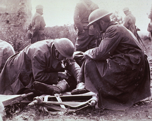<p>The Ambulance Company administering first aid at an advance dressing station in France during World War I.</p>