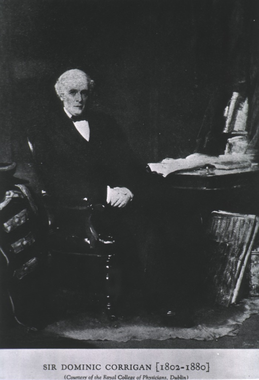 <p>Seated, full face, hands clasped in front.</p>