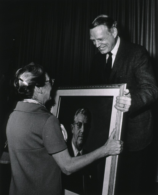 <p>Dr. John Sherman presents Mrs. James Shannon with a portrait of Dr. Shannon.</p>