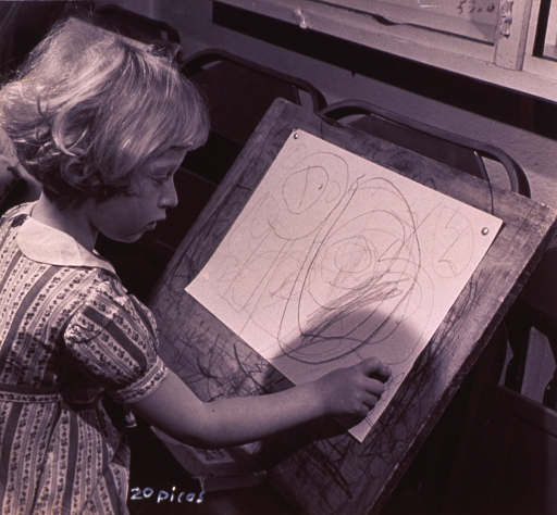 <p>A girl is drawing.</p>