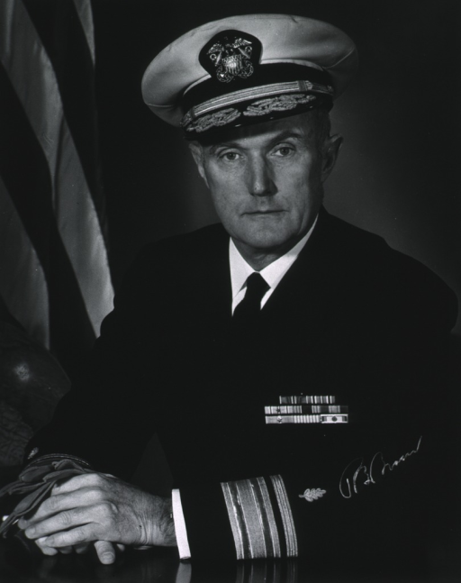 <p>Half-length, full face, seated, hands on table, wearing U.S. Navy uniform and cap.  Autographed.</p>