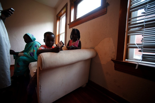 Sudanese refugees in their living room in Kansas City, Missouri. Although some refugees come to the United States with elevated blood lead, others are exposed only after their arrival. For these people, living in older housing with lead-based paint is often the cause of their exposure.Todd Feeback/Kansas City Star/MCT via Getty Images