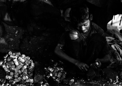 A Calcutta child working in a battery recycling shop. Shops like this are common in some developing countries—and a common source of lead exposure prior to emigration.© Philippe Lissac/Godong/Corbis