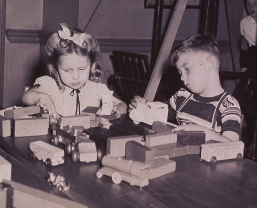 <p>Children playing with wooden blocks.</p>