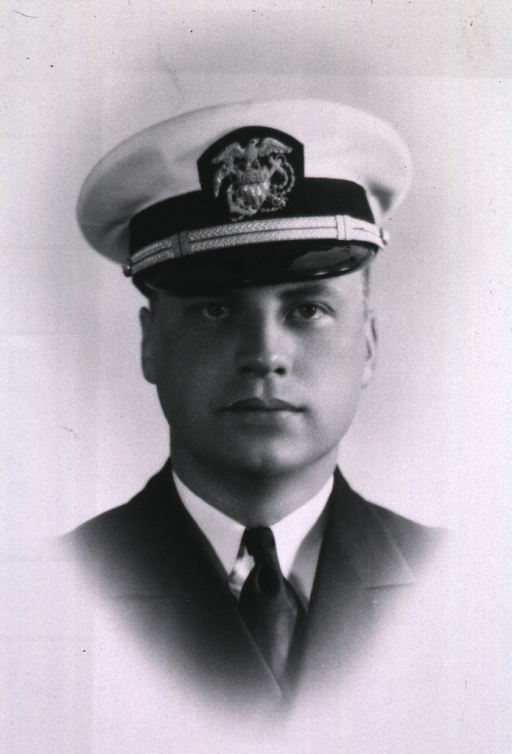 <p>Head and shoulders, wearing white cap with USPHS insignia.</p>