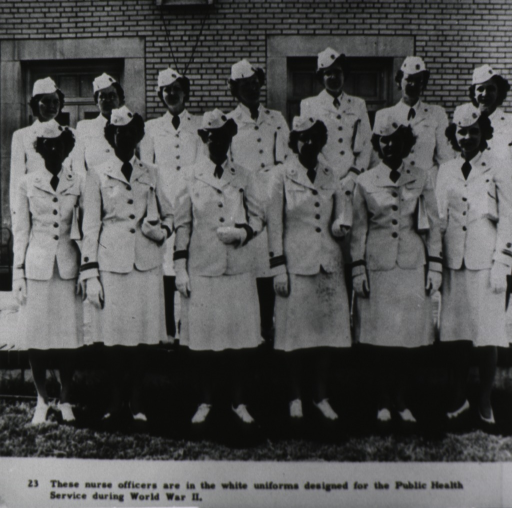 <p>Group of PHS nurse officers posed for photo in front of a building.</p>