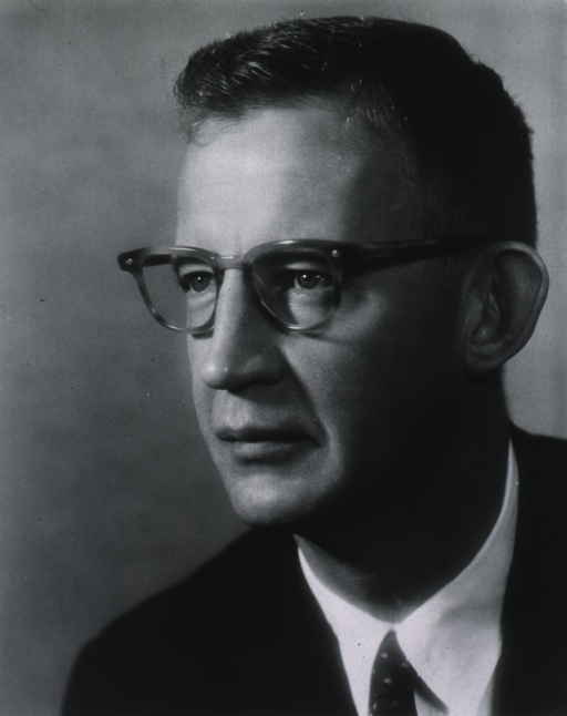 <p>Head and shoulders, turned to left, wearing glasses.</p>