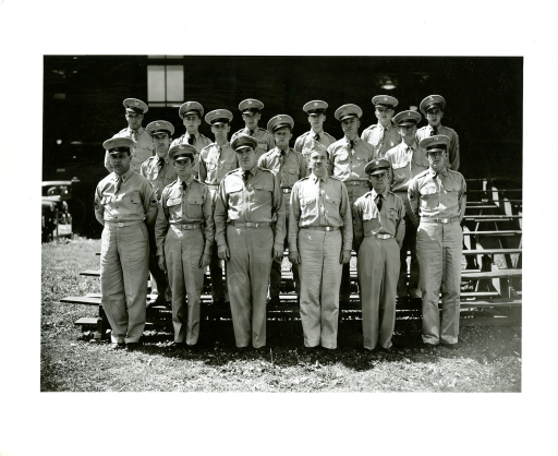 <p>Colonel Joseph H. McNinch, M.C., Director, Army Medical Library stands with Assistant Director Major Frank B. Rogers, M.C., as well as with a company of enlisted men from 9902nd Detachment.</p>