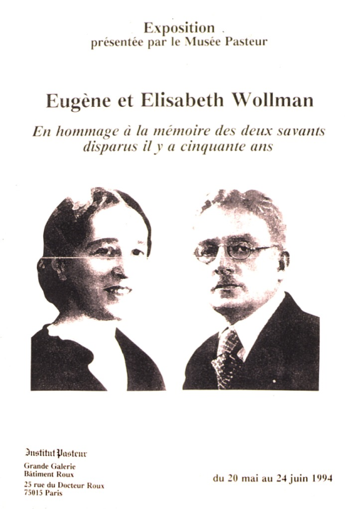 <p>Poster advertising an exhibition in honor of Eugene and Elisabeth Wollman, both known for their work in medicine and bacteriology.  Portraits of both dominate the poster.</p>