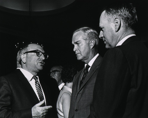 <p>Showing Dr. John Sherman, Dr. Robert Marston, and Wilbur Cohen at retirement party for Dr. James Shannon.</p>