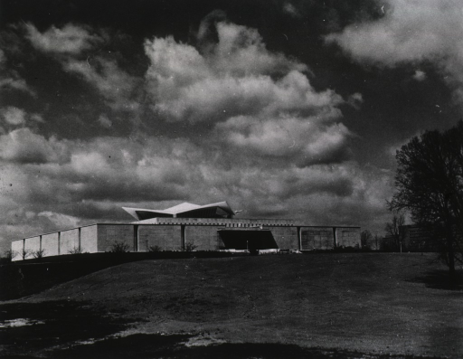 <p>Exterior view of the hyperbolic paraboloid form: front and south side.  National Institutes of Health buildings are in the right background.</p>