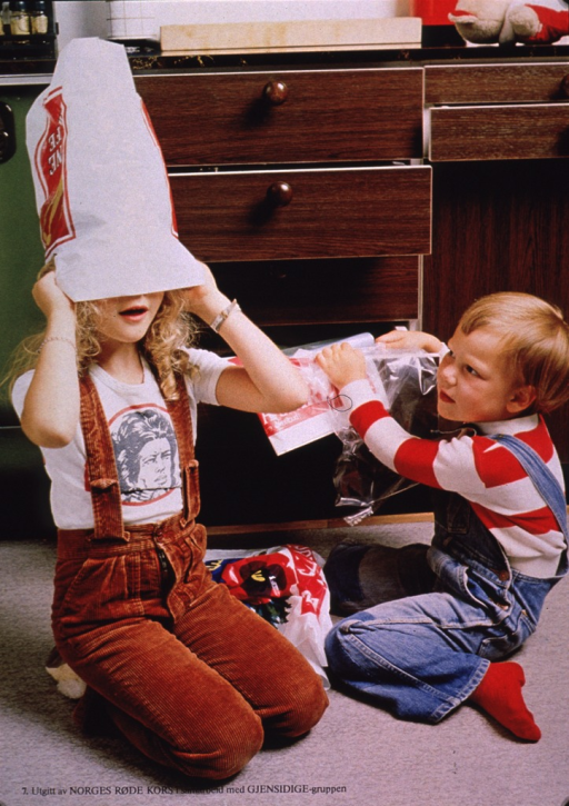 <p>Multicolor poster with black lettering.  Visual image is a color photo reproduction featuring a girl and boy sitting on the floor and playing with bags.  The girl has a bag most of the way over her head.  The boy is pulling a plastic bag from a drawer.  Publisher information at bottom of poster.</p>