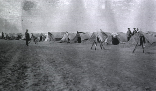 <p>Soldiers standing near their shelter tents at a Division Lazaret.</p>