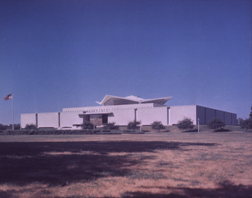 <p>Exterior view of the hyperbolic paraboloid form: front and north side; U.S. flag raised.</p>
