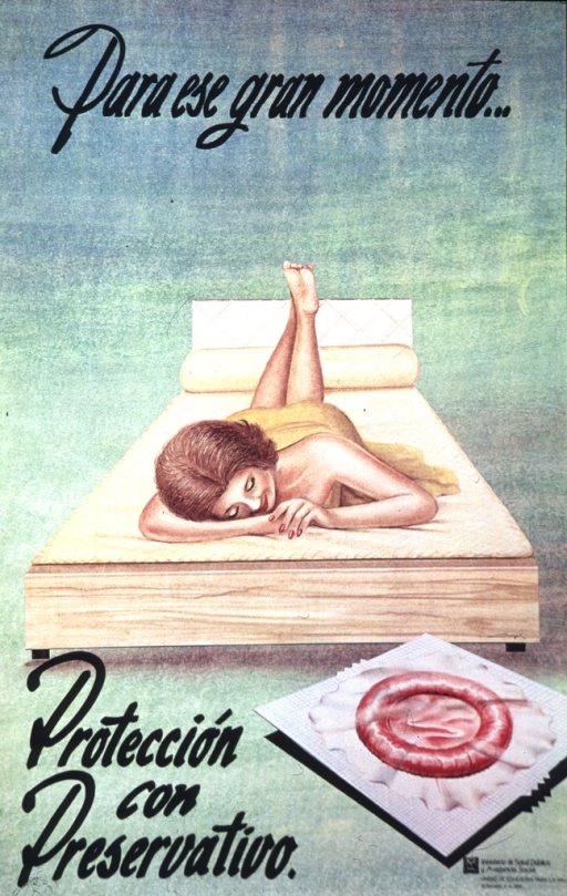 <p>English translation of the title: For the grand moment protect yourself with a condom.  A smiling woman is lying on her stomach on a bed.  Her head is at the foot of the bed.  A small blanket is covering her lower back.  A packaged condom is on the floor at the foot of the bed.</p>