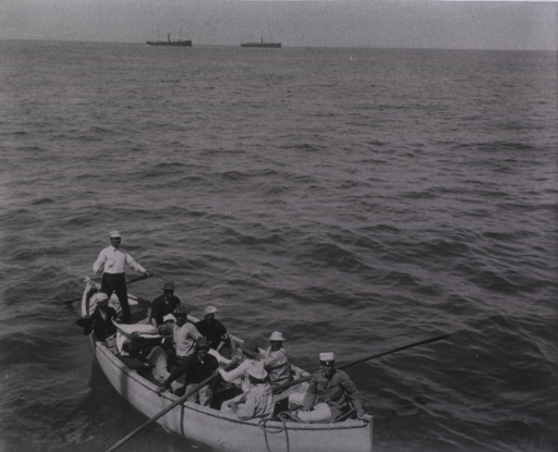 <p>View of wounded soldiers enroute to the Hospital Ship Relief aboard a boat.  Two ships are in the background.</p>