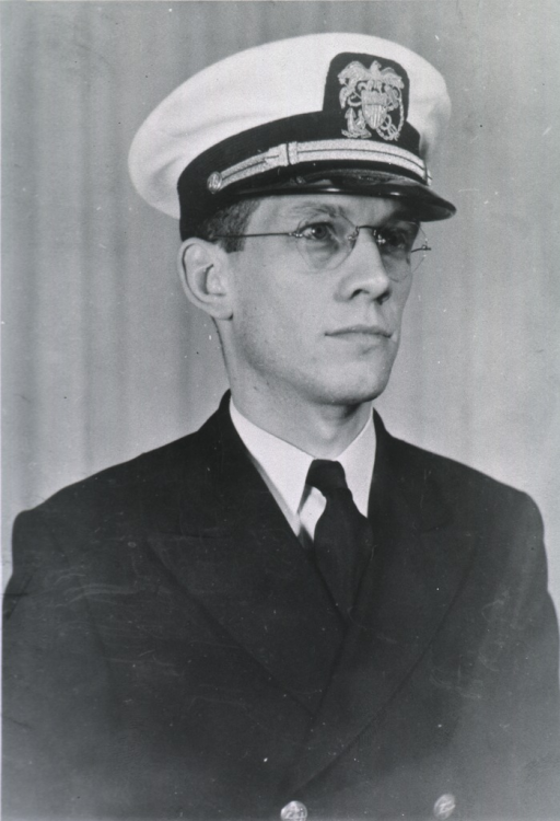 <p>Head and shoulders, full face, head to right, wearing white cap with USPHS insignia.</p>