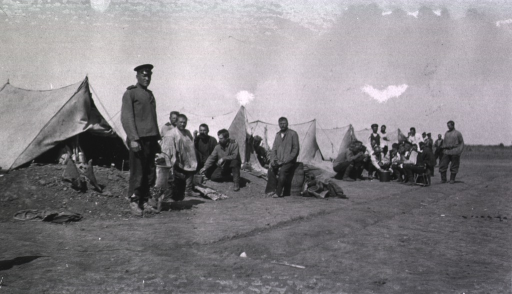 <p>Soldiers(?) near their tents, which are prepared for cold weather, at a Division Lazaret.</p>