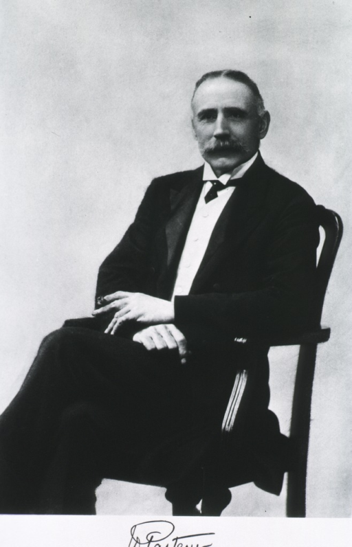 <p>Seated, left pose, face front, holding cigarette.</p>