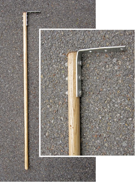 Millipede rake, consisting of a broom handle attached by nuts, bolts, and washers to a corner brace. Inset shows the rake head in detail.