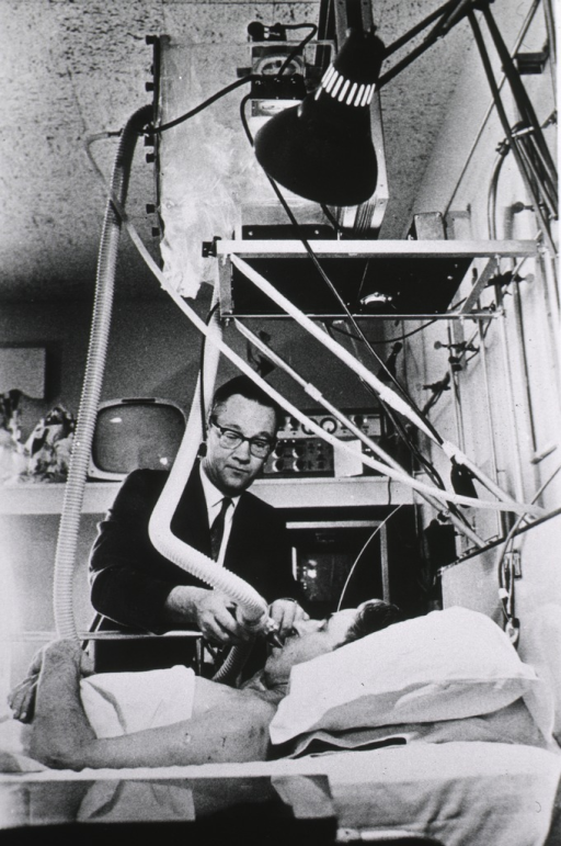 <p>Dr. Samuel R. Powers measures lung volume of patient undergoing treatment at the shock unit; various monitoring devices attached to the patient are hooked up with a computer</p>